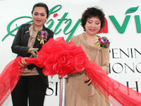 Dato Siti Nurhaliza and CEO Ms Lee at ribbon cutting at mark the opening ceremony